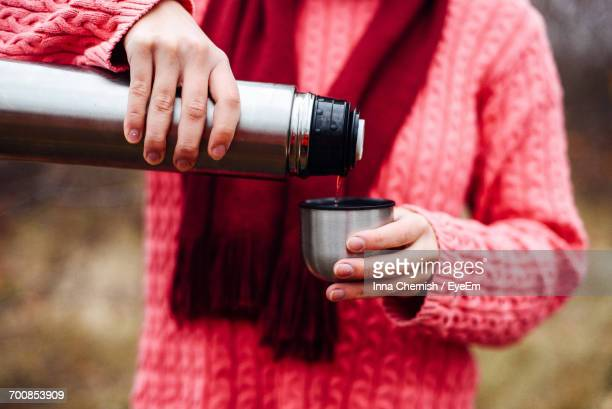 Close-Up Of Woman Pouring Tea