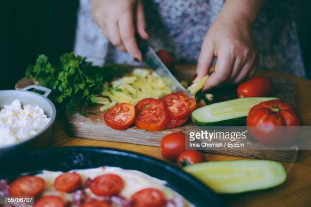 close-up of woman preparing food on cutting board - chop stock pictures, royalty-free photos & images