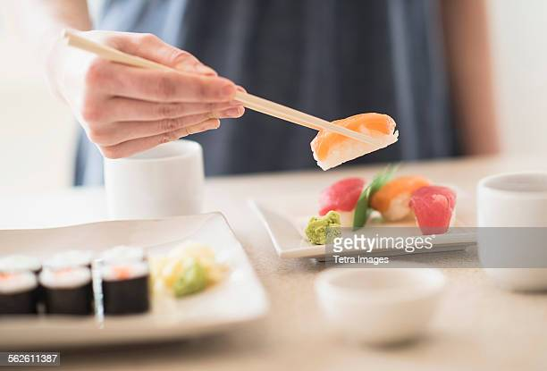 Close-up of woman preparing sushi