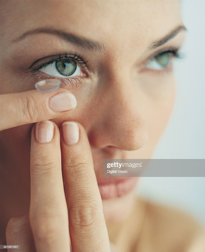 Close-up of Woman Putting on her Contact Lens : Stock Photo