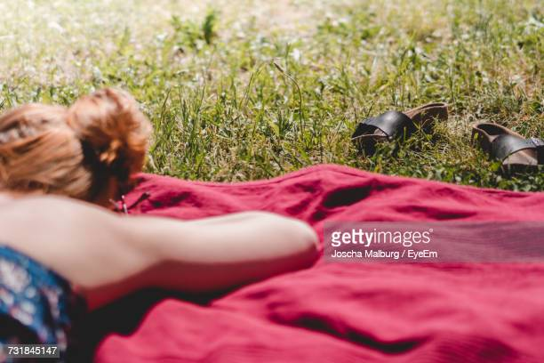 Close-Up Of Woman Relaxing On Grass
