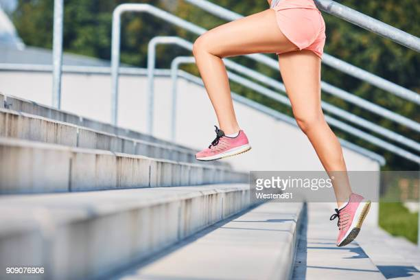 close-up of woman running on stairs - leg stock pictures, royalty-free photos & images