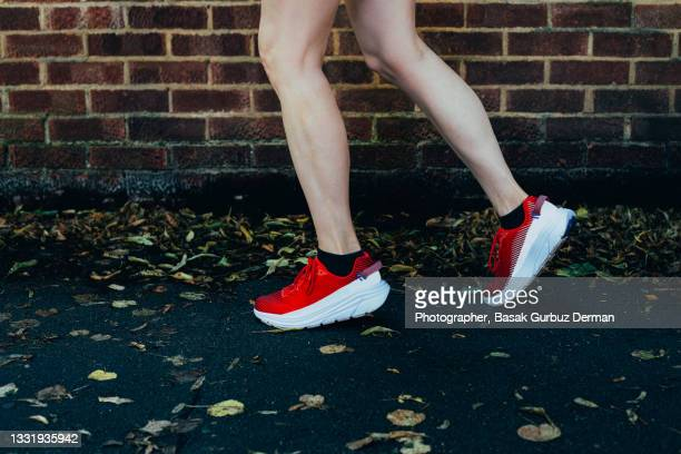 close-up of woman running - human foot stock pictures, royalty-free photos & images
