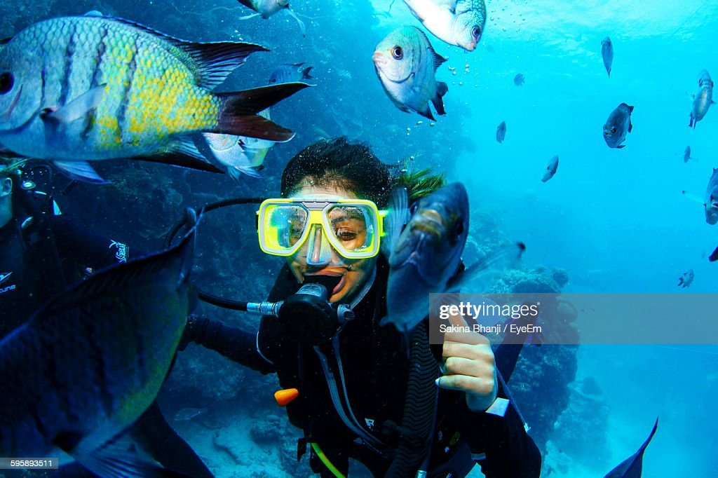 Close-Up Of Woman Scuba Diving In Great Barrier Reef : Stock Photo