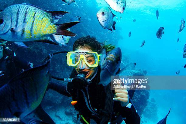 Close-Up Of Woman Scuba Diving In Great Barrier Reef