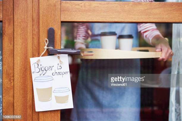 close-up of woman serving tray with coffee in a cafe - erschwinglich stock-fotos und bilder