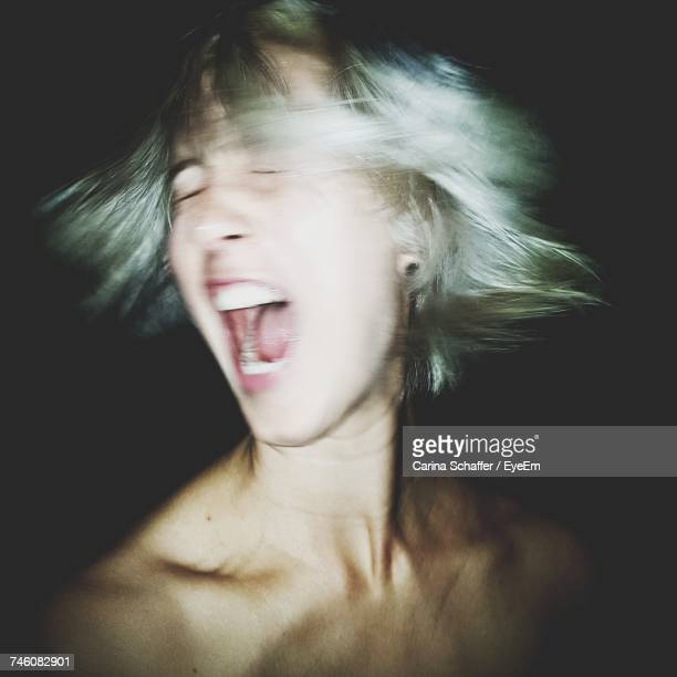 Close-Up Of Woman Shouting
