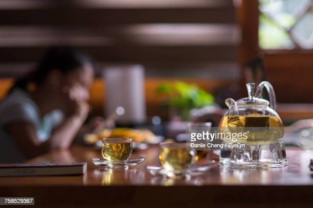 Close-Up Of Woman Sitting By Table