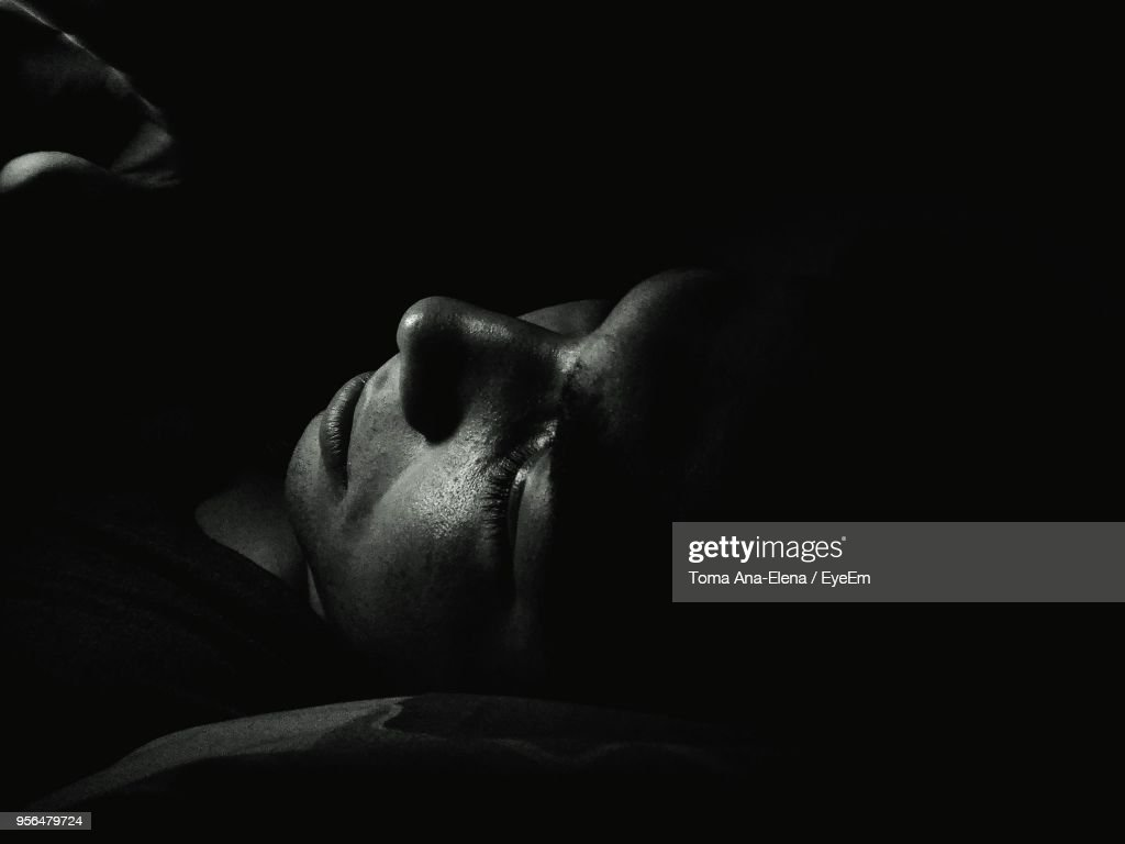 Closeup Of Woman Sleeping In Dark High Res Stock Photo Getty Images