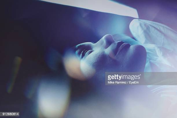 close-up of woman sleeping on bed - soñar despierto fotografías e imágenes de stock