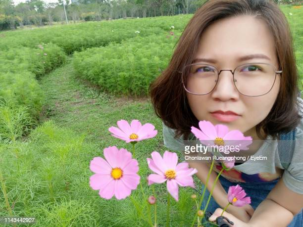 Close-Up Of Woman Smelling Flowers