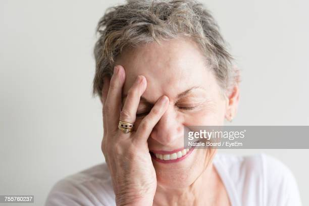 close-up of woman smiling - relief emotion stock pictures, royalty-free photos & images