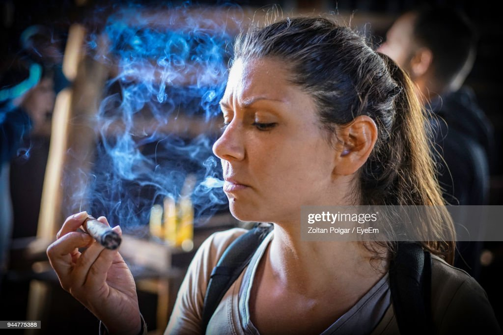 Close-Up Of Woman Smoking Cigar : Stock Photo