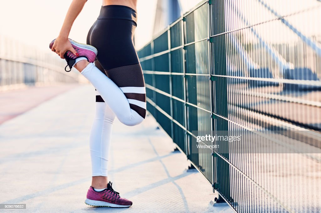 Close-up of woman stretching legs after running : Stock Photo