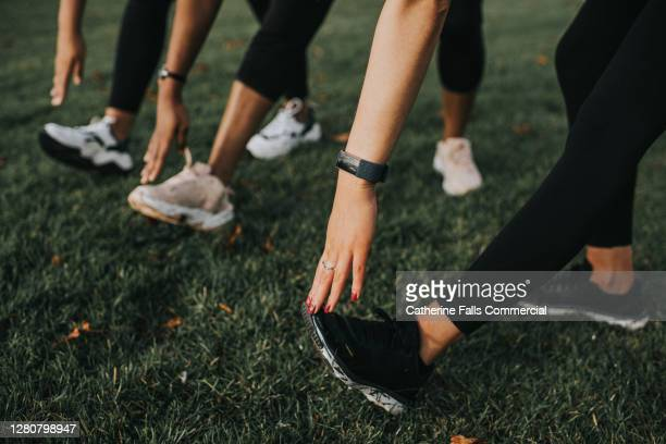close-up of woman stretching their hamstrings - running stock pictures, royalty-free photos & images