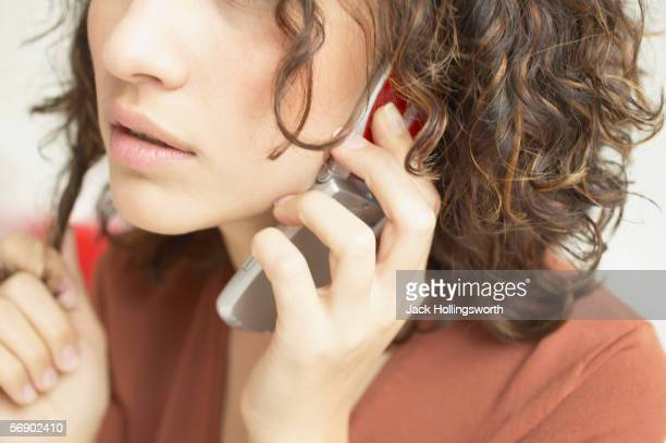 Close-up of woman talking on mobile phone