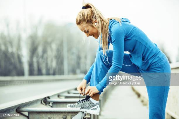 Close-Up Of Woman Tying Shoelace
