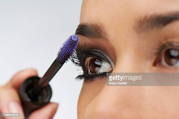 close-up of woman using eyelash brush - mascara stock pictures, royalty-free photos & images