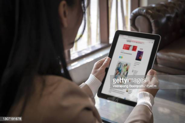 close-up of woman using mobile phone - article stock pictures, royalty-free photos & images
