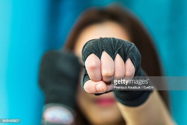 Close-Up Of Woman Wearing Boxing Gloves