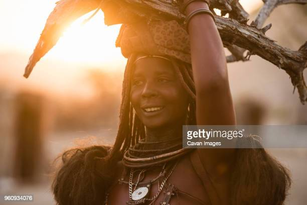 close-up of woman wearing carrying firewood on head - namibia fotografías e imágenes de stock