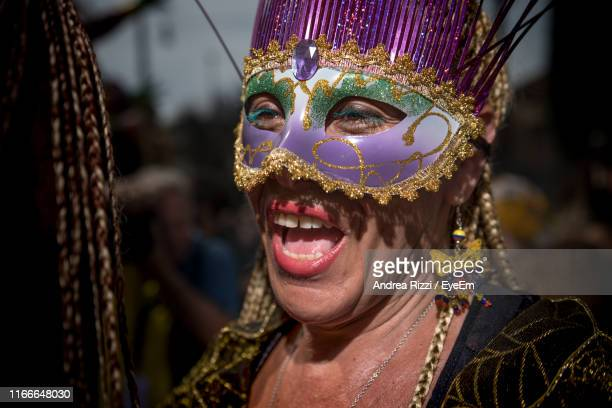 close-up of woman wearing eye mask during event in city - andrea rizzi stock pictures, royalty-free photos & images