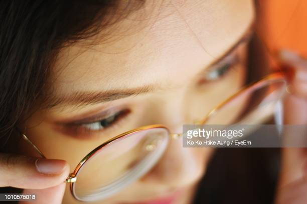 close-up of woman wearing eyeglasses - ko ko htike aung stock pictures, royalty-free photos & images
