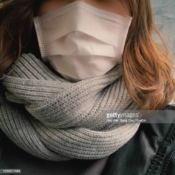close-up of woman wearing face mask - coronavirus winter stock pictures, royalty-free photos & images