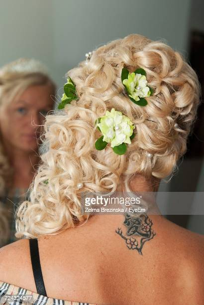 Close-Up Of Woman Wearing Flowers