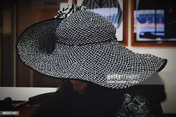 Close-Up Of Woman Wearing Hat At Home