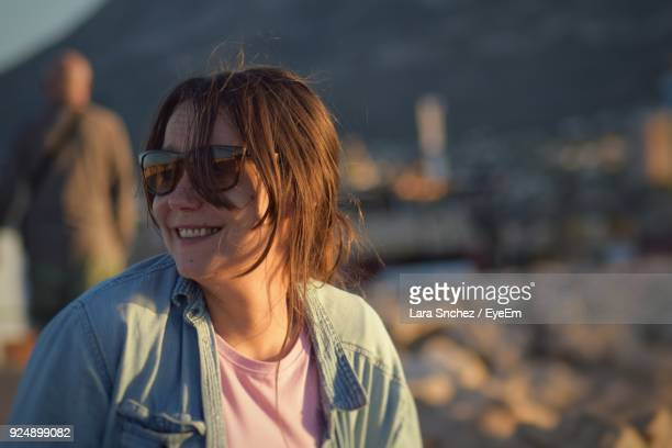 Close-Up Of Woman Wearing Sunglasses During Sunset