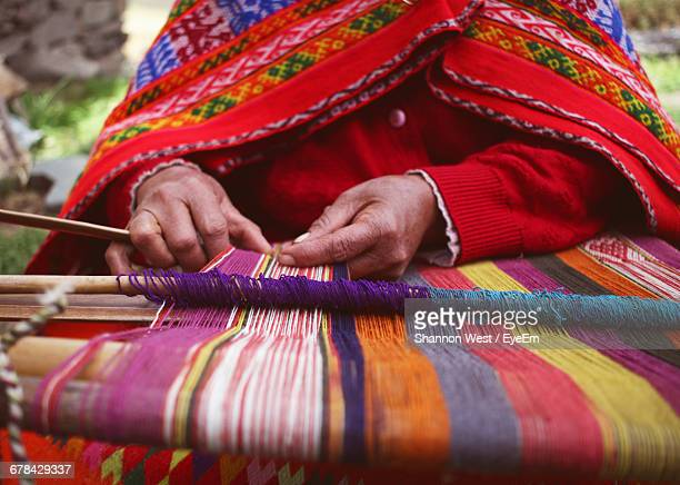 Close-Up Of Woman Weaving