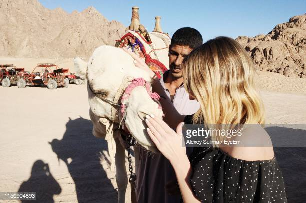 close-up of woman with camel at desert - sharm el sheikh foto e immagini stock