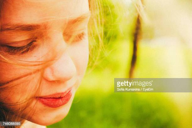 Close-Up Of Woman With Closed Eyes In Sunny Day