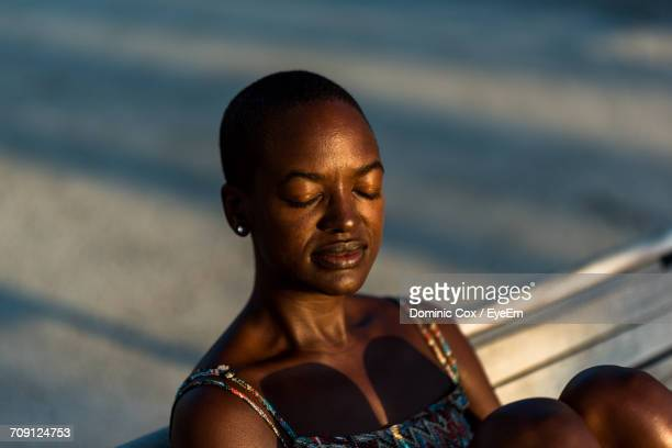 close-up of woman with closed eyes - shaved head stock pictures, royalty-free photos & images