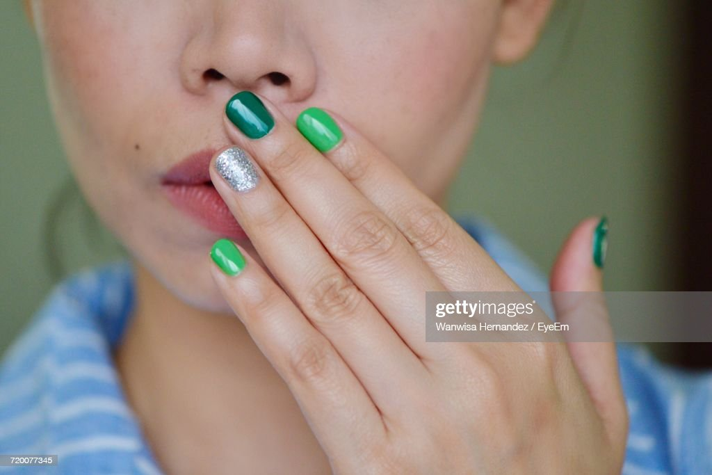 Close-Up Of Woman With Colorful Nails : Stock Photo