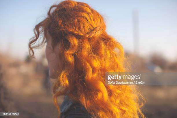 Close-Up Of Woman With Curly Red Hair
