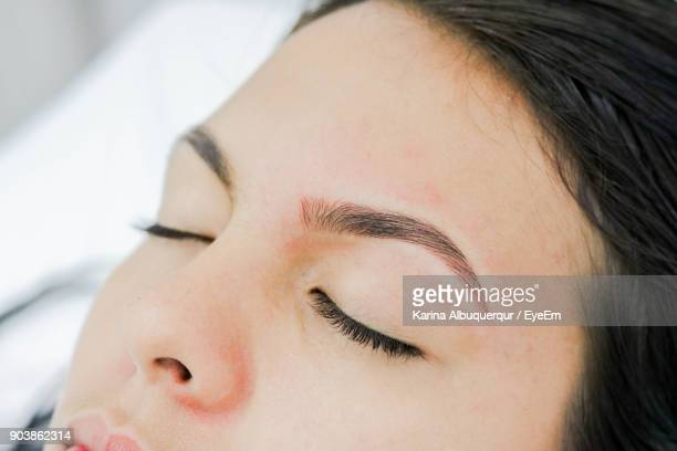 close-up of woman with eyes closed - forehead stock pictures, royalty-free photos & images
