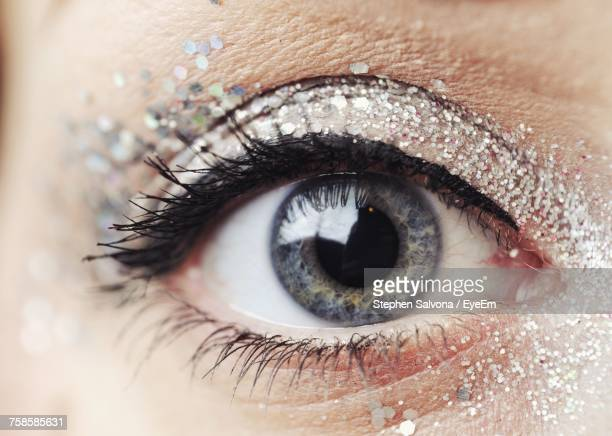 close-up of woman with glitter eyeshadow - eye make up stock photos and pictures