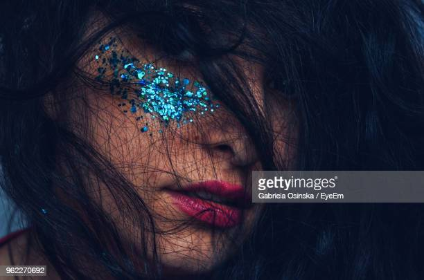 Close-Up Of Woman With Glitter On Her Face