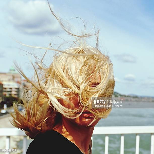 Close-Up Of Woman With Hair Blowing In Breeze