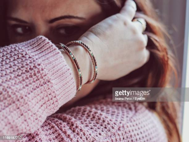 close-up of woman with hand in hair - province of caltanissetta stock photos and pictures