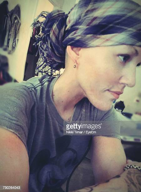 Close-Up Of Woman With Headscarf Suffering From Cancer