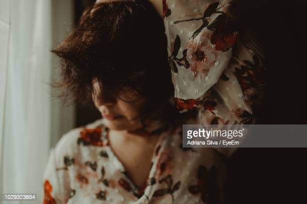 close-up of woman with messy hair at home - imperfection stock pictures, royalty-free photos & images