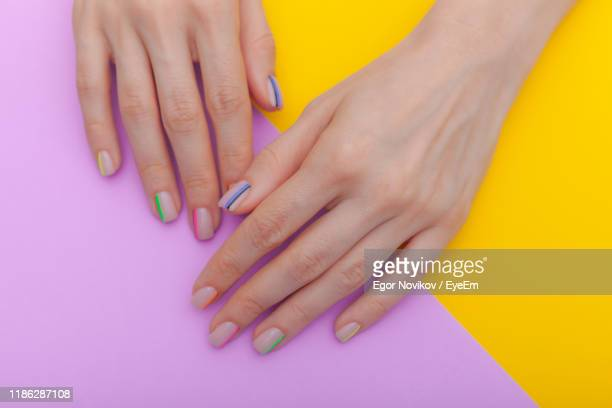 close-up of woman with nail art on colored background - nail art stock pictures, royalty-free photos & images