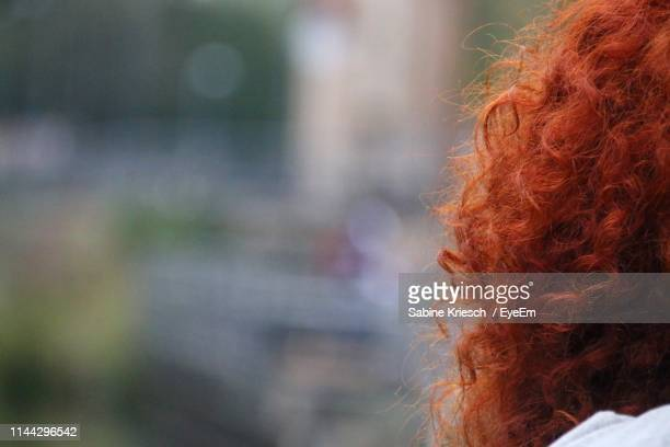 close-up of woman with redhead - sabine kriesch stock-fotos und bilder