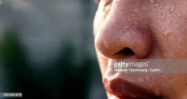 close-up of woman with sweat on face - damp lips stock pictures, royalty-free photos & images