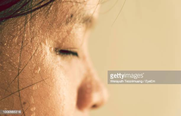 close-up of woman with sweat on face - sweat stock pictures, royalty-free photos & images
