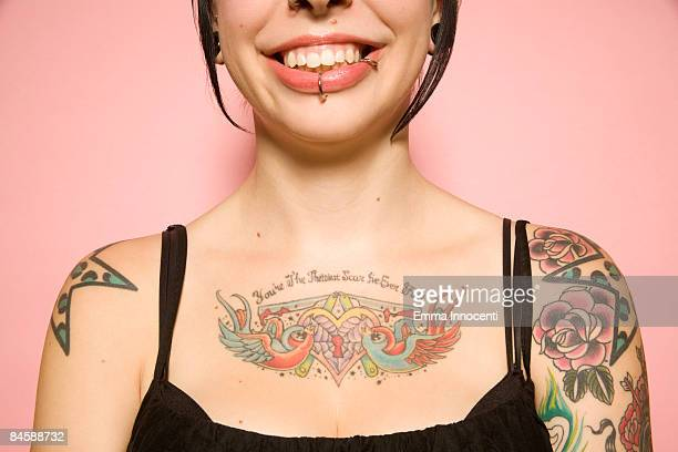 close-up of woman with tattoos on pink background - spaghetti straps stock pictures, royalty-free photos & images