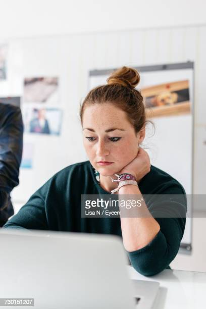 Close-Up Of Woman Working In Office